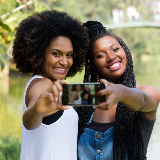 Friendship with Women taking selfie